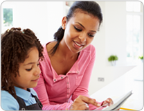 Parent with child doing Vocabulary Homework on a Tablet